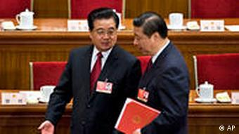 FILE - In this March 13, 2009 file photo, Chinese President Hu Jintao, left, chats with Vice President Xi Jinping as they leave the Great Hall of the People after the closing ceremony of the National People's Congress in Beijing, China. Chinese Vice President Xi has been promoted to vice chairman of a key Communist Party military committee, state media reported Monday, Oct. 18, 2010, in the clearest sign yet he is on track to be the country's future leader. (AP Photo/Andy Wong, File)
