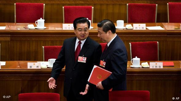 Chinese President Hu Jintao, left, chats with Vice President Xi Jinping as they leave the Great Hall of the People after the closing ceremony of the National People's Congress in Beijing, China. Photo: AP Photo/Andy Wong, File