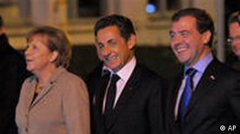German Chancellor Angela Merkel, French President Nicolas Sarkozy, and Russian President Dmitry Medvedev