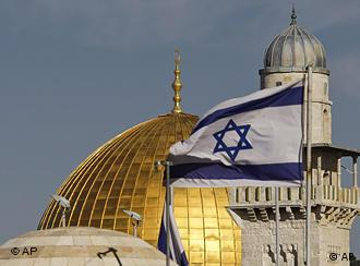 An Israeli flag flies next to Jerusalem's Dome of the Rock