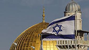 An Israeli flag is seen back-dropped by the Dome of the Rock Mosque in Jerusalem's Old City