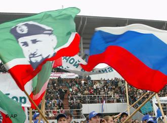 Young Chechens wave Russian flags and flags of Chechnya