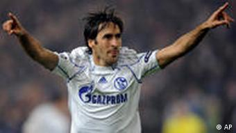 Schalke's Raul of Spain celebrates his opening goal during the Champions League Group B soccer match between FC Schalke 04 and Hapoel Tel Aviv, in Gelsenkirchen, Germany, Wednesday, Oct. 20, 2010.