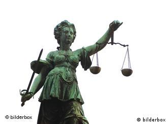 Statue of the goddess Justice holding scales
