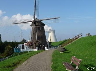 Doel's 17th-century windmill in the foreground, in the background a nuclear power plant