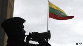 The Myanmar flag is hoisted outside the town hall in Yangon