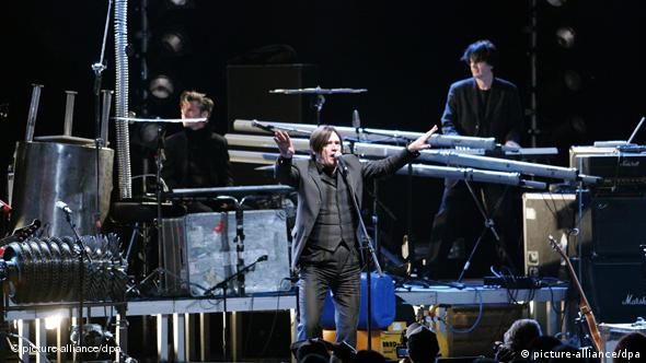 Einstürzende Neubauten performing on stage with industrial tools used as instruments Photo: Soeren Stache dpa +++(c) dpa - Bildfunk+++