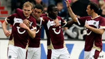 Hannover players celebrate a goal