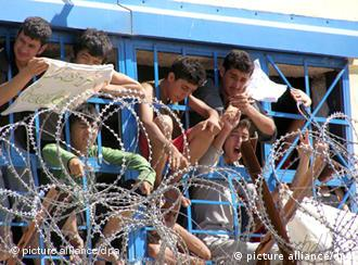 illegal immigrants behind barbed wire.
