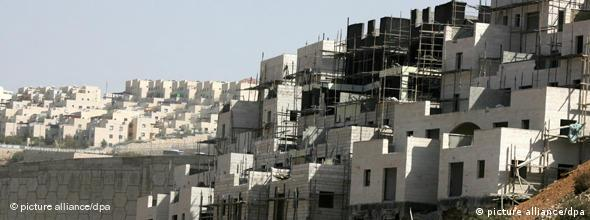 Palestinian men work at a construction site in the Israeli settlement of Beitar Illit in the West Bank