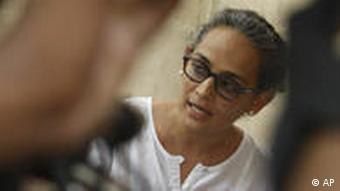Writer activist Arundhati Roy speaks during a meeting protesting the killing of freelance journalist Hem Chand Pandey in a police encounter, in New Delhi, India, Wednesday, July 7, 2010.