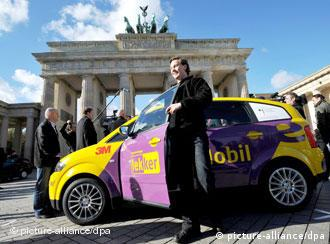 An electric car in front of the Brandeburg Gate in Berlin