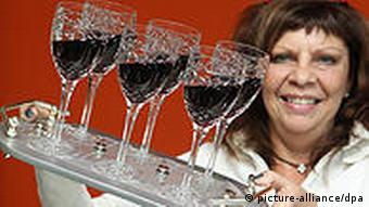Inventor Barbara Willomat presents her safety tray which stabilises glasses on trays