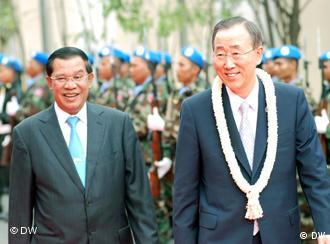 Cambodian Prime Minister Hun Sen (left) and UN Secretary-General Ban Ki-moon and at a parade in Pnomh Penh