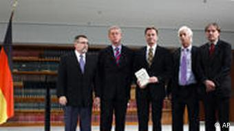 German Foreign Minister Guido Westerwelle, center, receives a report by four historians, Peter Hayes, Eckart Conze, Moshe Zimmermann, and Norbert Frei, from left, about the Foreign Ministry's Nazi past in Berlin, Germany, on Thursday, Oct. 28, 2010. (AP Photo/Markus Schreiber)