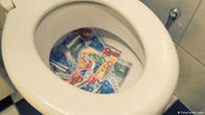 Symbolbild Geldverschwendung Geld Klo Toilette Finanzkrise (Fotolia/mik ivan)