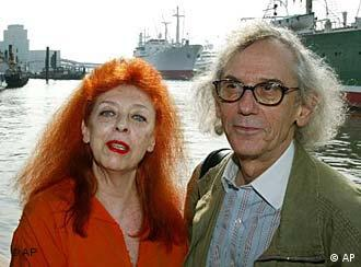 Christo and Jeanne-Claude stand before a harbor