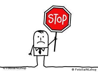 Карикатура: человечек с табличкой ''Стоп!''