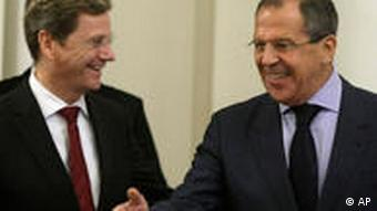 Guido Westerwelle, Sergei Lavrov, talking and smiling