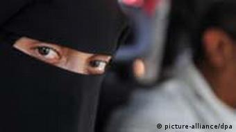 Person in a black mask in Yemen