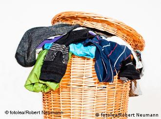 A basket overflowing with dirty laundry