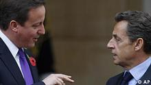 French President Nicolas Sarkozy, right, talks to British Prime Minister David Cameron as they arrive at Lancaster House in London for a summit on defence and security cooperation treaty between their two countries, Tuesday, Nov. 2, 2010. (AP Photo/Sang Tan)