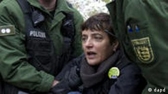 Police carry a demonstrator away