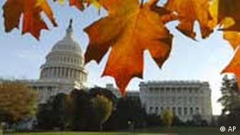 The U.S. Capitol and House of Representatives is seen through fall foliage