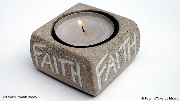 A candle in a stone. Photo: Fotolia_8746815_Towards Ithaca - Fotolia 2008