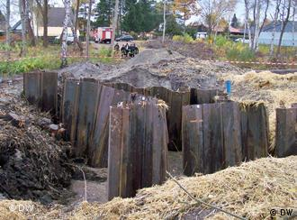sheet pilings in a huge bomb crater