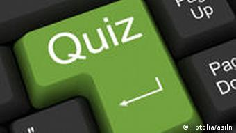 A keyboard with the word quiz superimposed on a green key