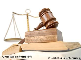 A picture of a court gavel, legal books and a set of scales