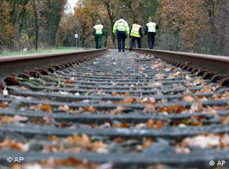Police on train tracks