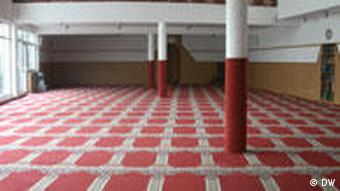Mosque's prayer room with red carper