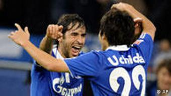Schalke's Raul of Spain, left, celebrates his opening goal with Schalke's Atsuto Uchida of Japan during the German first division Bundesliga soccer match between FC Schalke 04 and FC St. Pauli in Gelsenkirchen , Germany, Friday, Nov. 5, 2010.