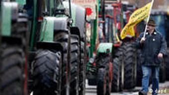 Man walks along line of tractor blockade