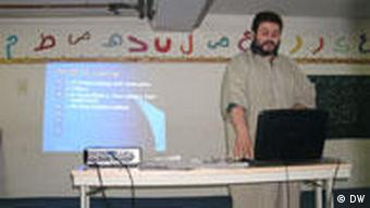 Tutor with beard in front of his Power Point presentation