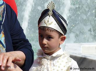 A young Turkish boy dressed up before his circumcision ceremony