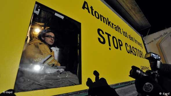 Greenpeace activists sits in truck blockade