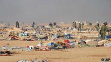 In this photo released by the MAP news agency (Maghreb Arabe Presse) shows Moroccan forces dismantle a camp housing thousands of refugees in the Western Sahara, near Laayoune, Monday Nov. 8, 2010. At least three Moroccan security officials were killed and 70 injured Monday in a raid on a protest camp in the disputed territory of Western Sahara and unrest that then spread to a nearby city, where several buildings were set on fire. (AP Photo/MAP/HO)