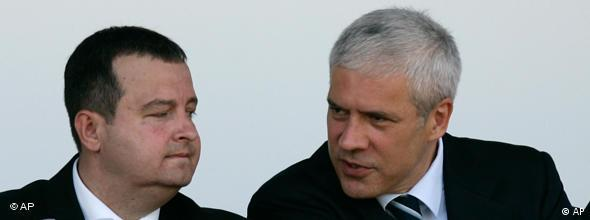 Serbian President Boris Tadic, center, speaks with Interior Minister Ivica Dacic, left, during an police exercise, in Belgrade, Serbia, Sunday, June 7, 2009. Serbia's Prime Minister Mirko Cvetkovic, on the right, gestures. (AP Photo/Darko Vojinovic)