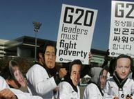 国际乐施会(Oxfam)的活动家在G20峰会前戴上20国集团领导人面具呼吁人们关注贫穷问题