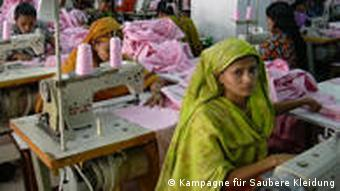 Woman at sewing machine in Dhaka factory