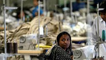 A Bangladeshi woman works in a textile factory on the outskirts of Dhaka, Bangladesh, Wednesday, Feb. 2, 2005. The European Union has decided to give Bangladesh zero tariff entry into its $ 70 billion clothing market from July this year, a move that may boost the country's export to the EU, according to media reports. Bangladesh, a nation of 140 million people, earns three-fourths of its foreign exchange from textile exports. The industry directly employs 1.8 million people and indirectly provides work for about 5 million. (AP Photo/Manish Swarup)