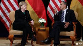 President Barack Obama, right, meets with German Chancellor Angela Merkel on the sidelines of the G-20 summit in Seoul, South Korea, Thursday, Nov. 11, 2010. (AP Photo/Charles Dharapak)