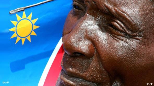 Face in front of Namibian flag