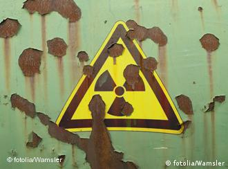 A nuclear sign on a rusty metal container