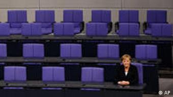 Merkel in empty parliament assembly