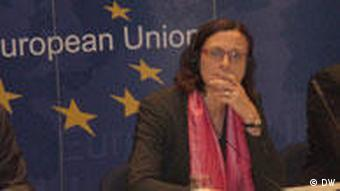 Cecilia Malmström in front of an EU flag with stars.