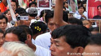 Members of the National League for Democracy party (NLD) gather in front of the party Headquarters
